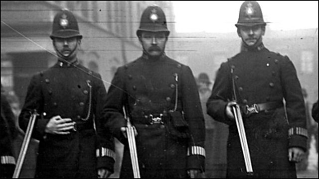 Photograph of three policemen with shotguns